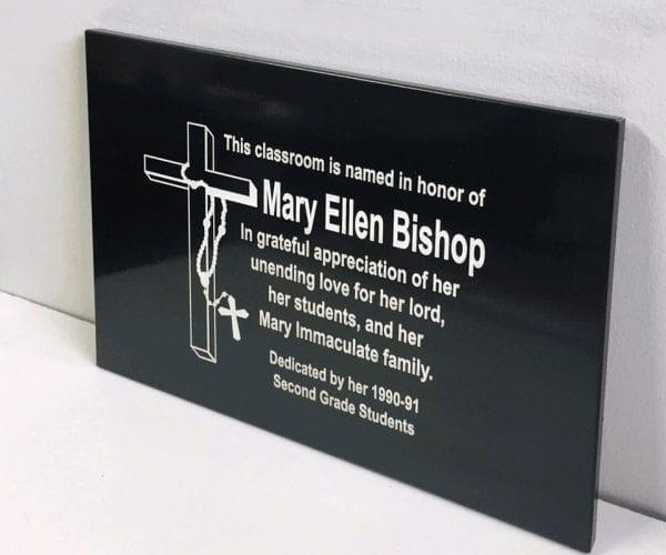 Memorial dark metal plaque